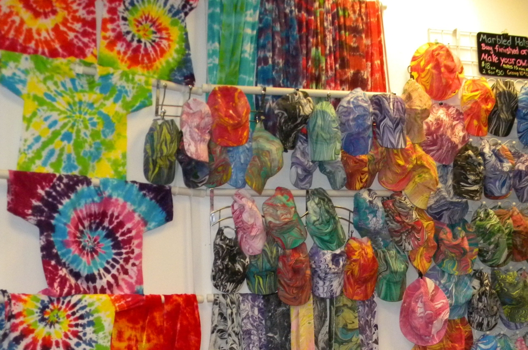Tie-dyed T-shirts and marbled caps at Harmony Arts Cafe in Brattleboro, Vermont